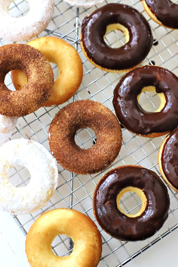 You can use a butter knife to spread the frosting onto the donuts or just drop a donut into the bowl to coat the top. Give a little twist and lift out to a rack to harden.
