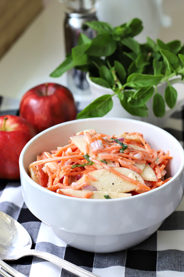 An easy recipe for a fresh and healthy salad or side dish, apple carrot slaw is colorful, crunchy and flavorful with the brightness of basil.