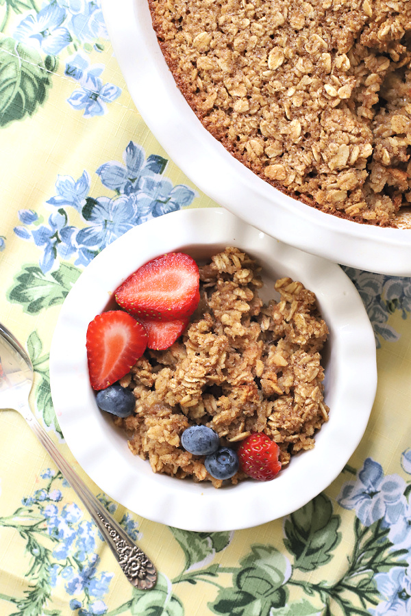 Easy recipe for a lightened version of baked oatmeal. Applesauce is substituted for some of the butter but it is still delicious and a great breakfast with milk, fruit or yogurt.