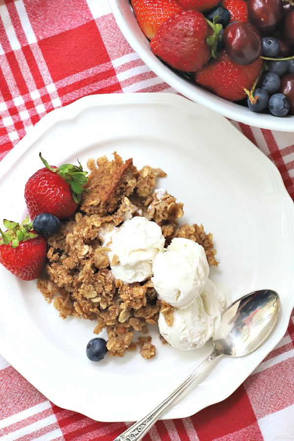 serving homemade baked oatmeal with vanilla ice cream with berries for dessert
