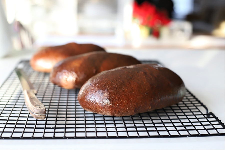 Easy recipe for delicious, honey wheat dark brown bread using a bread machine for the dough. Slightly sweet from molasses similar to Outback or Lone Star loaves.