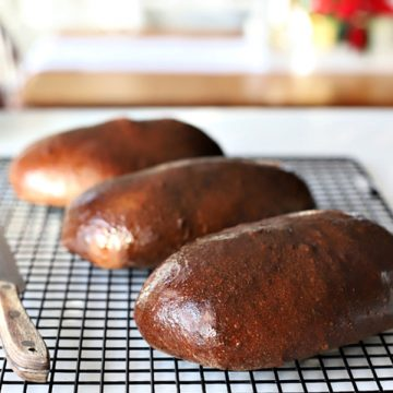 Honey wheat, dark brown bread is an easy recipe using a bread machine for the dough. Slightly sweet from molasses similar to Outback loaves.
