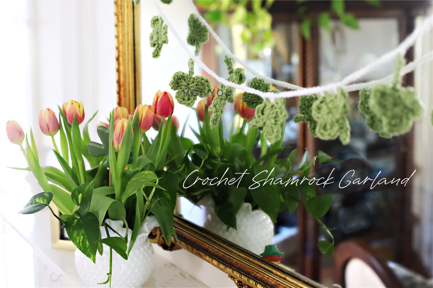 Crochet shamrock garland for S Patrick's Day swaged over mantle mirror