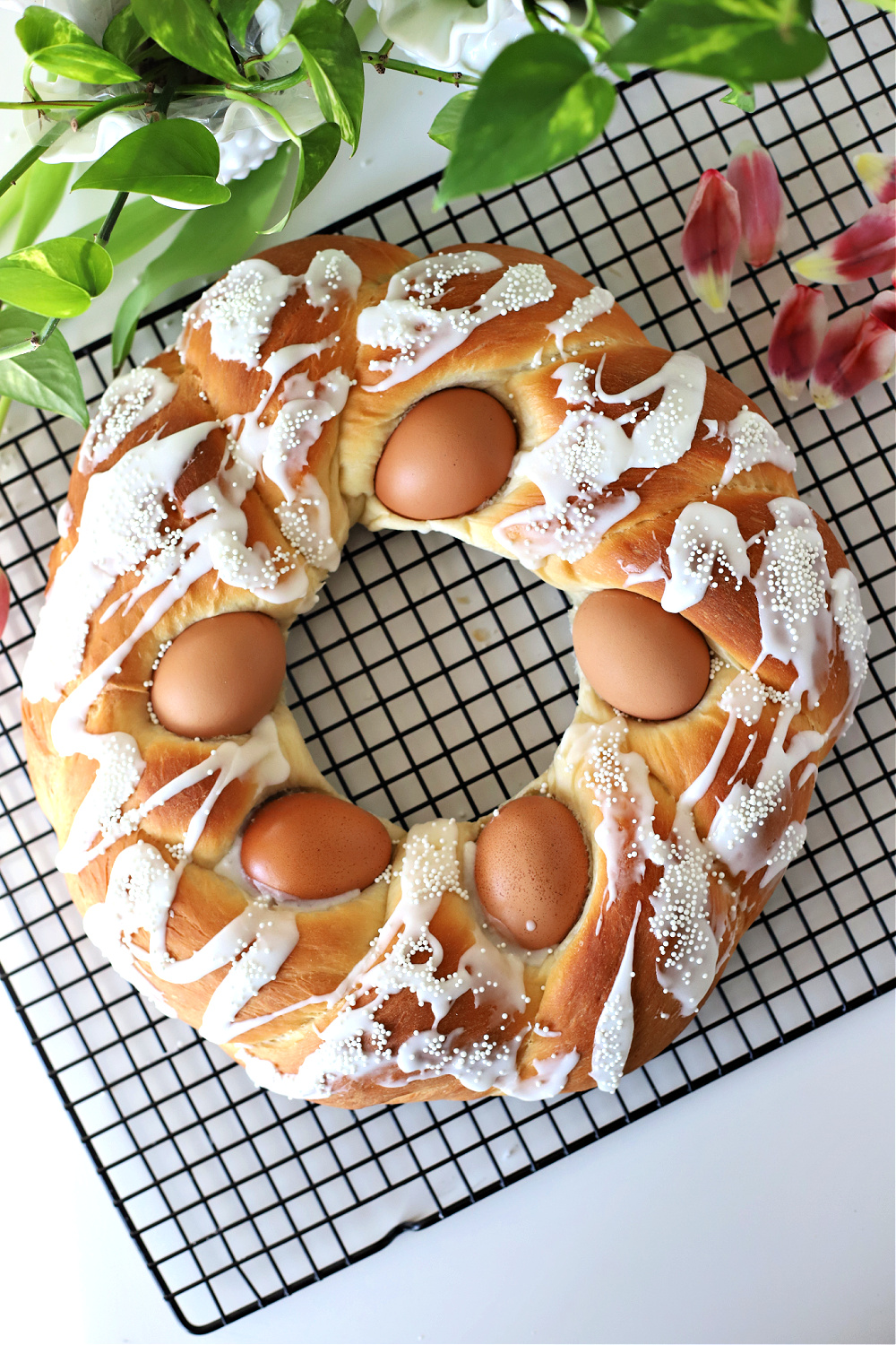 Using natural or dyed eggs you can make a beautiful sweet Easter bread. It is so easy especially when you let a bread machine do most of the work making the dough. An easy recipe for a lovely holiday breakfast.