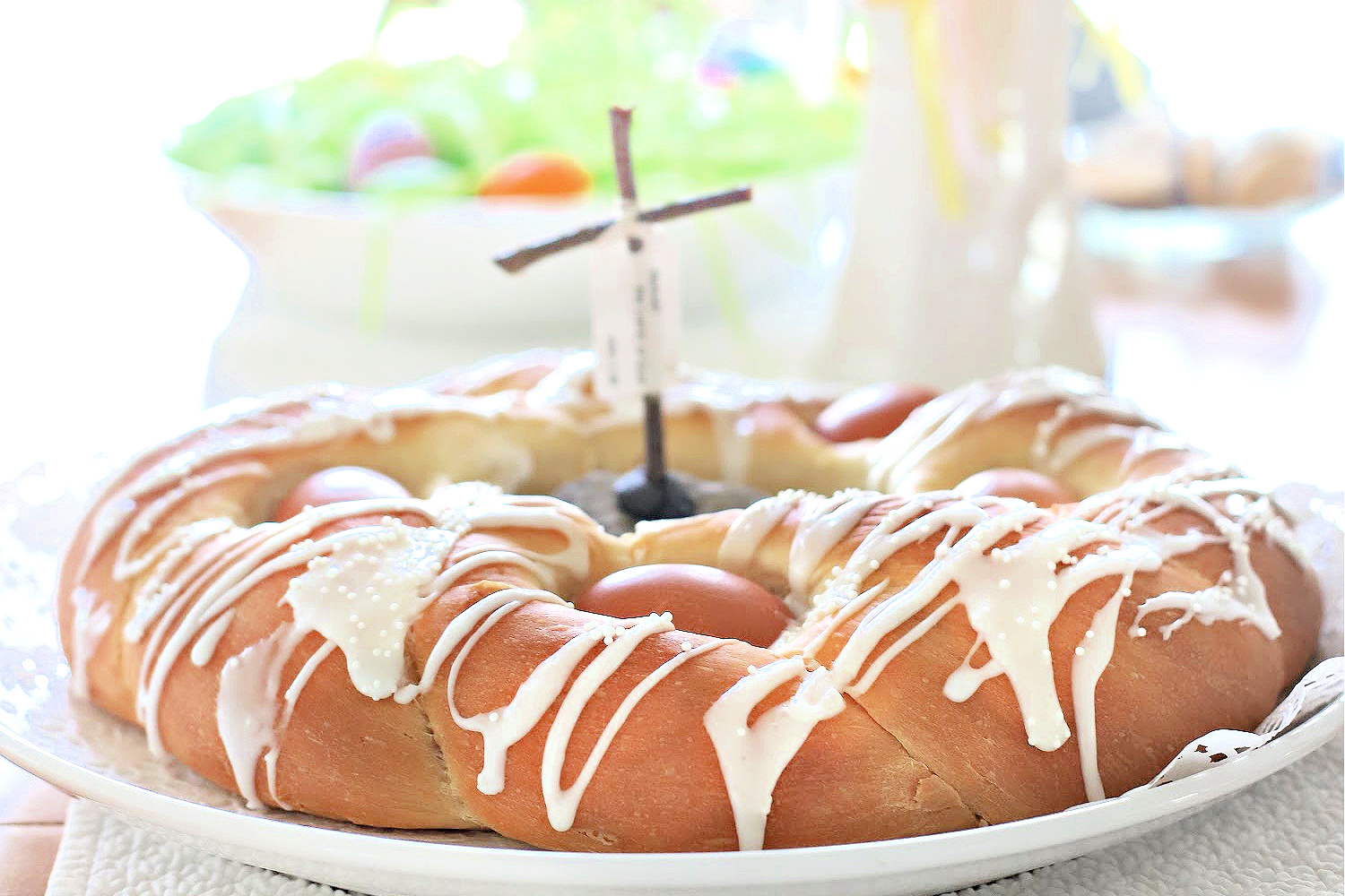 Make a beautiful Easter bread with natural or dyed eggs using a bread maker for the sweet dough.