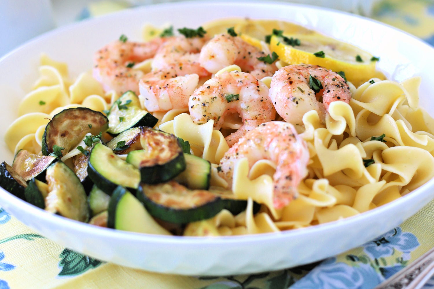 Serve this amazing one pan lemon shrimp over noodles or rice for a meal sure to impress. It couldn't be tastier or easier to make. A quick and easy recipe using butter and Italian Seasoning Mix and baked in the oven.