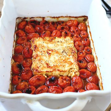 Easy & tasty recipe for baked tomato & feta perfect for pasta. Seen on TicTok, cherry tomatoes are roasted with olive oil and seasoning.
