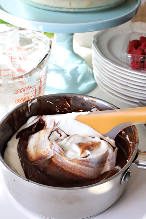 folding fresh whipped cream into melted chocolate for chocolate cream pie recipe