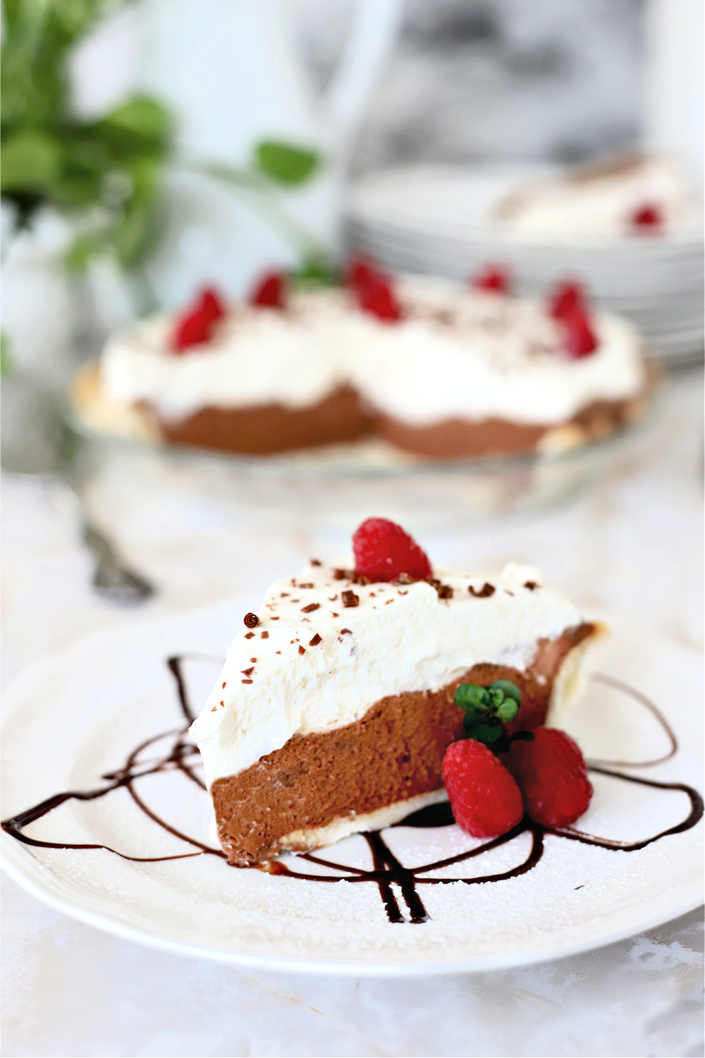 Easy recipe for a creamy, decadent chocolate cream pie with cream cheese and dark chocolate chips using a homemade or refrigerator pie crust.