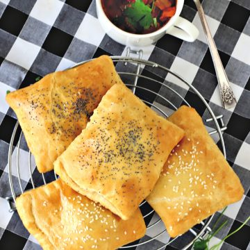 Easy recipe for ham & cheese hand pies are a quick and easy lunch or dinner hot sandwich. Fill crescent roll dough with Swiss, cheddar or American cheese, sprinkle with poppy or sesame seeds, if desired and bake!