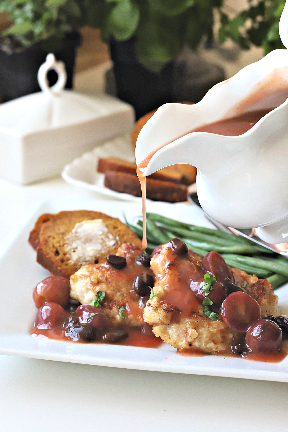 An easy recipe for breast of chicken with grape sauce looks elegant and involved. Cooked in a skillet and saucepan and served with baked ham.