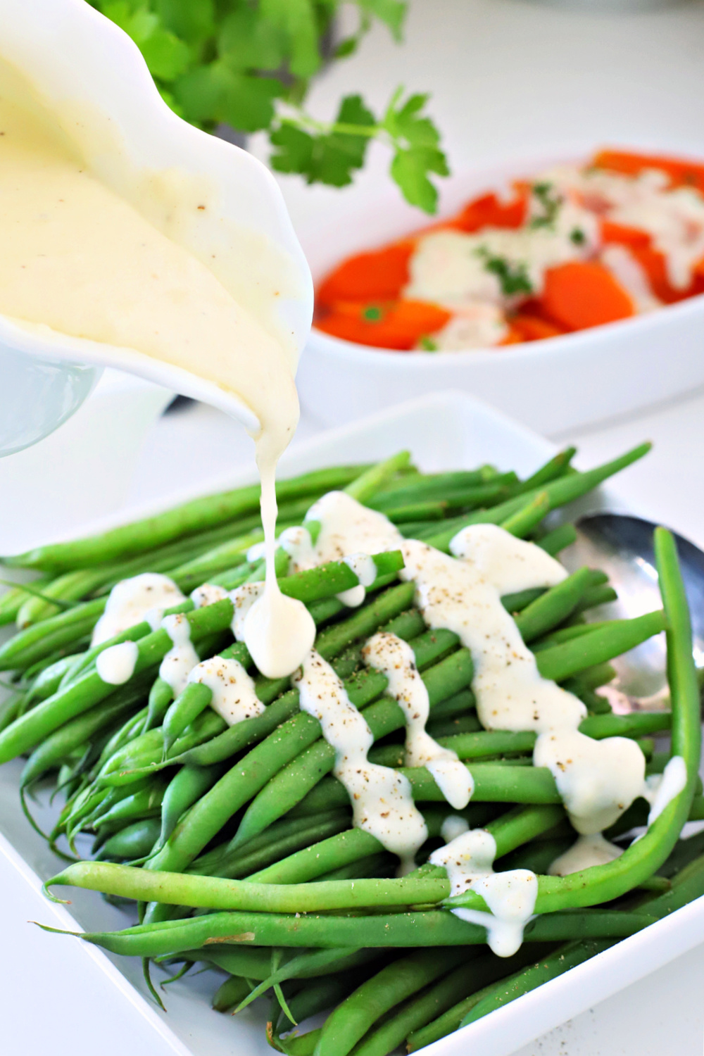 No more boring veggies! Kick up the flavor of your carrots, green beans and broccoli with a quick and easy recipe for creamy cheese sauce. Add to your weeknight or holiday meals like Easter, Thanksgiving and Christmas dinner.