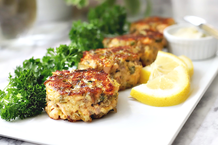 Easy recipe for golden brown pan-fried fresh salmon patties with chopped veggies, mayo and Old Bay. Serve these cakes with a tasty tartar sauce.