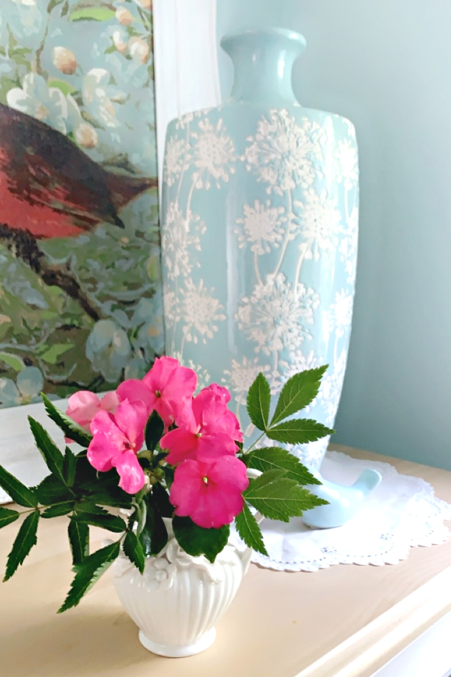 Impatiens gathered after the rain are displayed in a tiny vase to brighten the powder room.