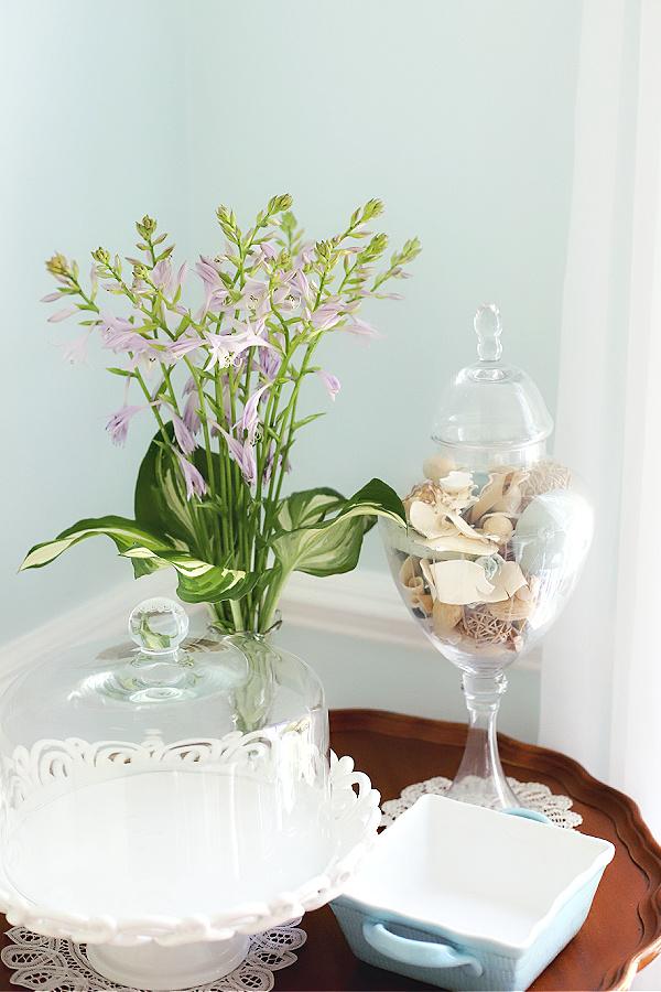 Simple flower arrangement of hosta flowers and leaves