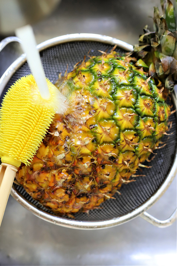 washing a pineapple prior to cutting