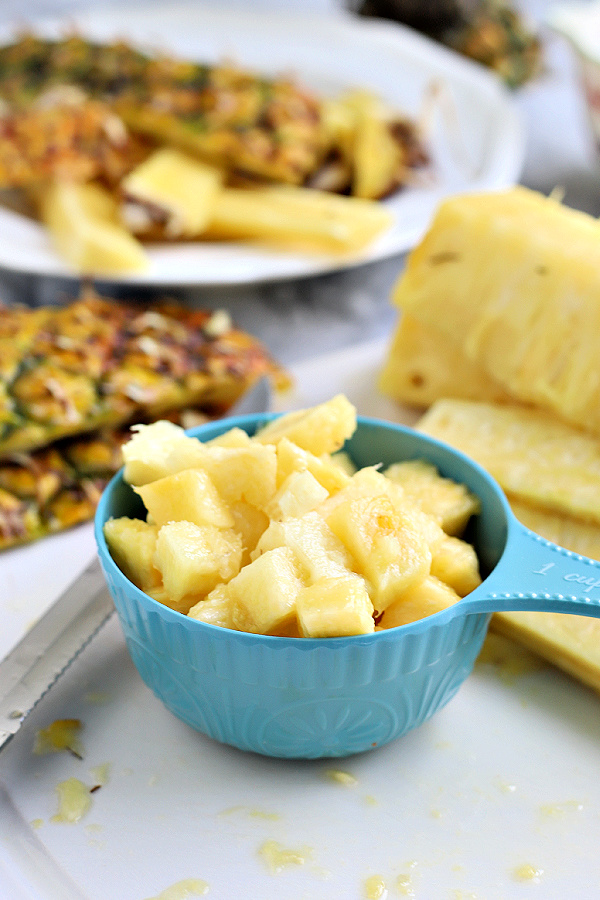 chopping fresh pineapple
