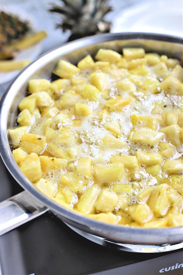 simmering fresh pineapple with sugar for Pineapple jam