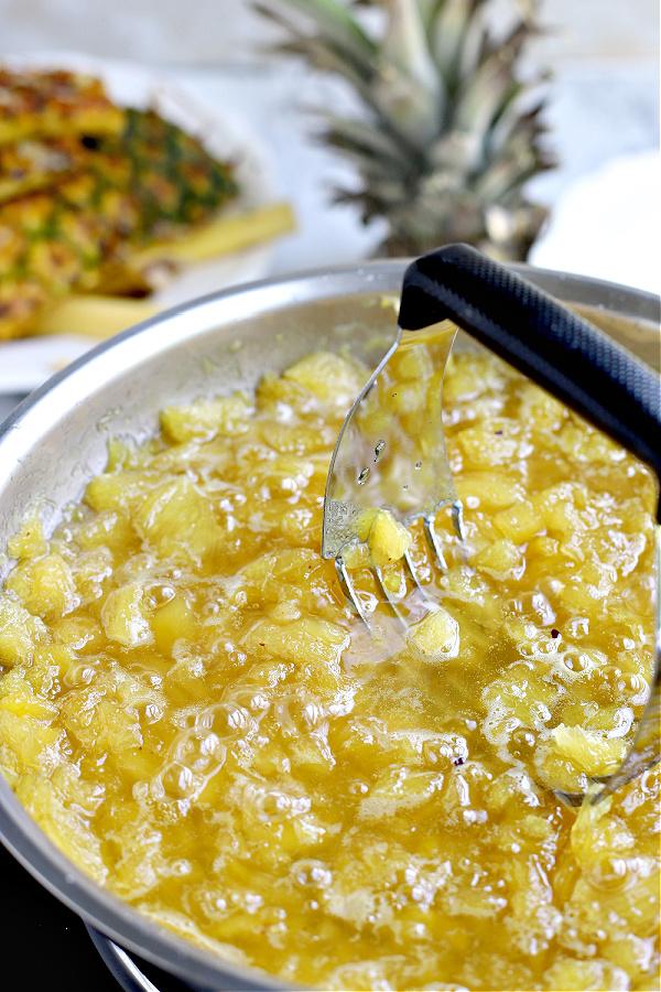 mashing fruit for Pineapple jam