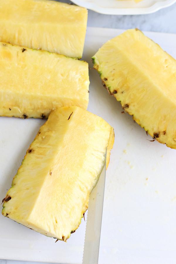 cutting a fresh pineapple