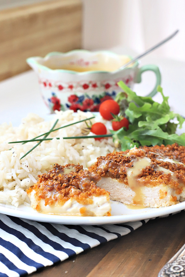 Juicy chicken breasts with a crispy Parmesan and panko coating is oven baked rather than fried. Easy recipe for Parmesan crusted chicken with honey mustard.