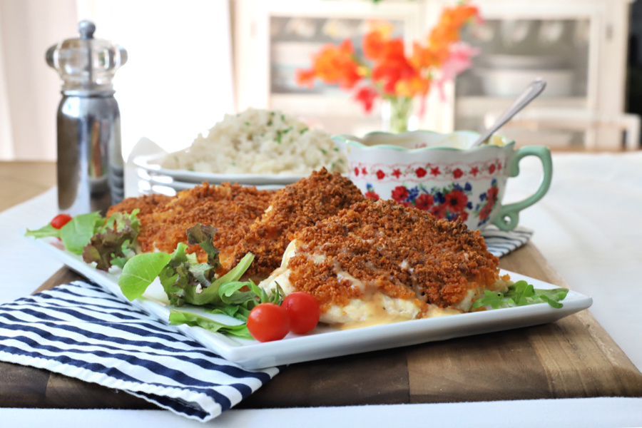 Parmesan crusted chicken with honey mustard sauce is oven baked rather than fried and delicious with a crunchy panko breadcrumb topping.